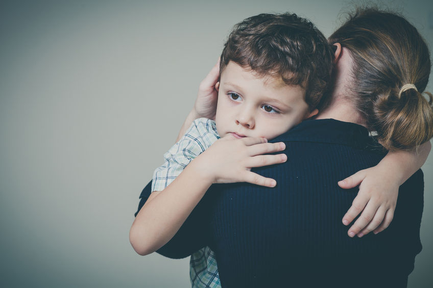49451782 - sad son hugging his mother at home. concept of couple family is in sorrow.