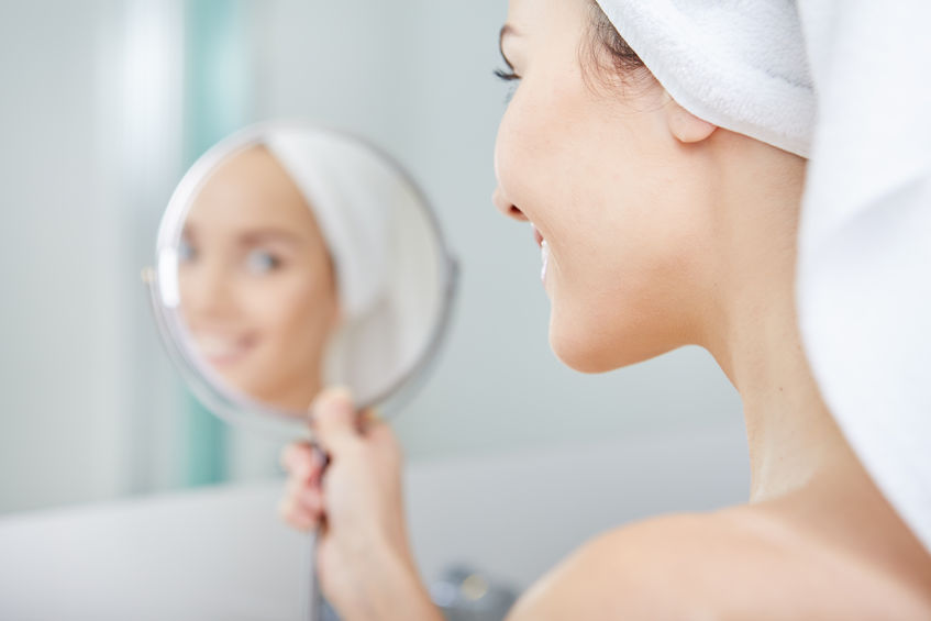 51686264 - face of young beautiful healthy woman and reflection in the mirror