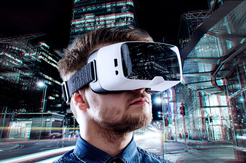 53460574 - man wearing virtual reality goggles against illuminated night city