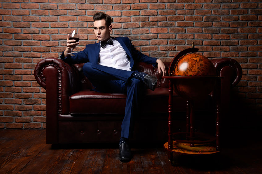 67990363 - imposing well dressed man in a luxurious apartments with classic interior. luxury. men's beauty, fashion.