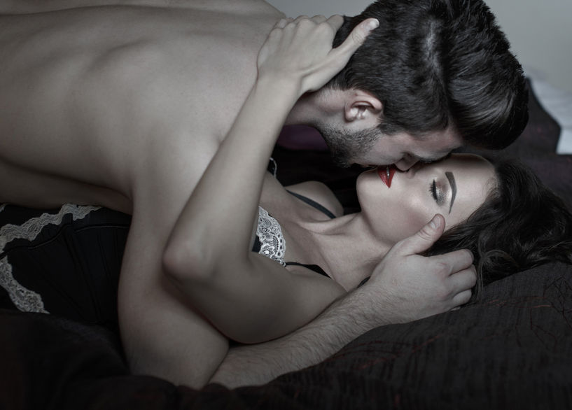73348971 - passionate couple kissing in bed at night