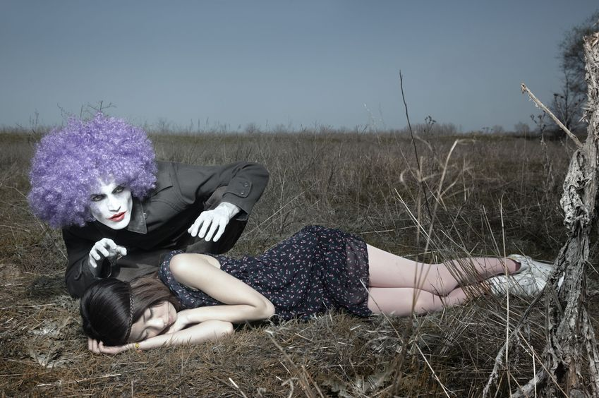 7670778 - sleeping girl outdoors and crazy maniac clown touching her shirt. artistic colors added