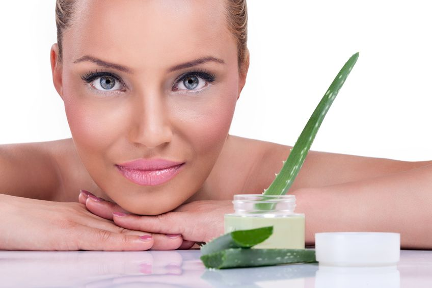 15259542 - beautiful woman with healthy skin posing next cream of aloe vera