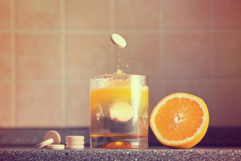 22610413 - artistic shot of vitamin c family, orange, tablet stack, dissolving tablet