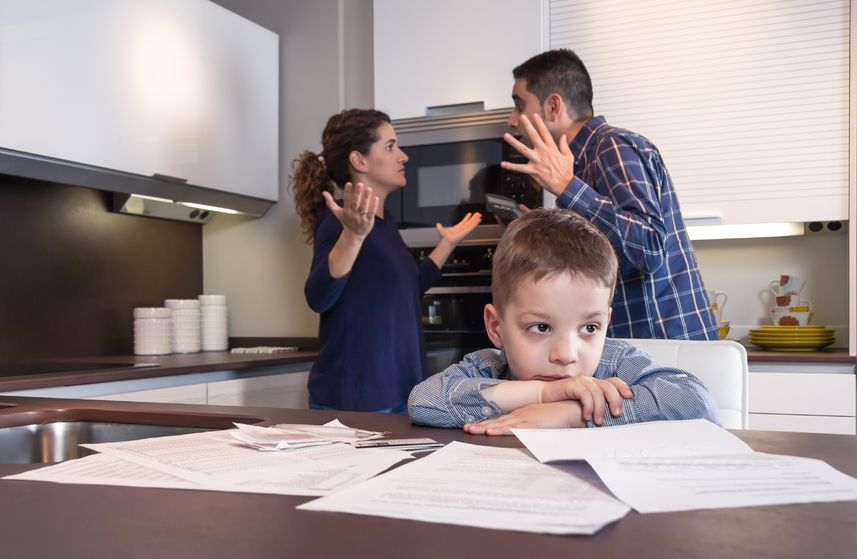 29272419 - sad child suffering and his parents having hard discussion in a home kitchen by couple difficulties family problems concept
