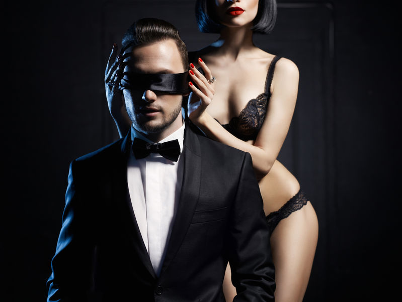 36812068 - fashion studio photo of a sensual couple in lingerie and a tuxedo