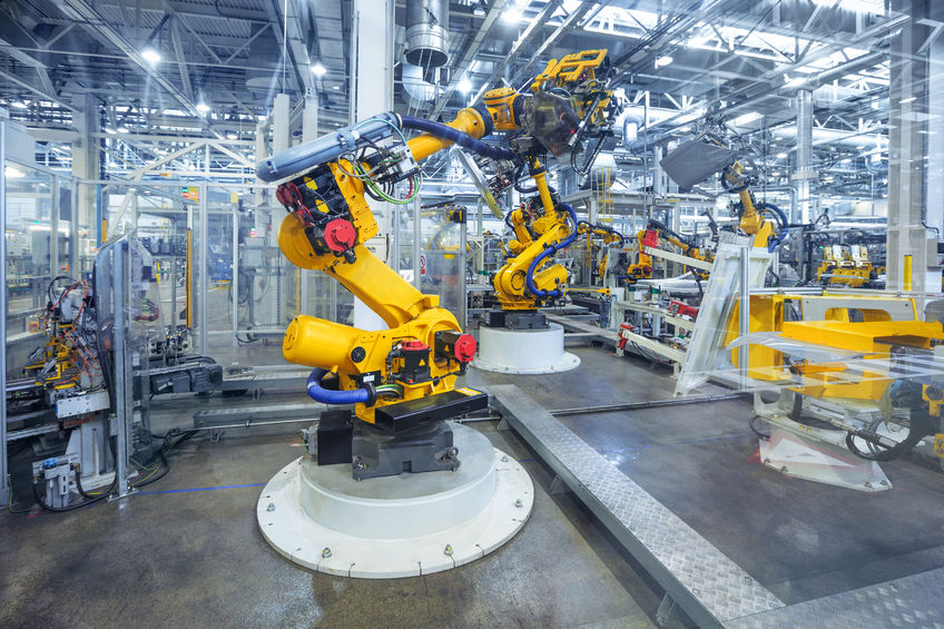 43486761 - robotic arms in a car plant