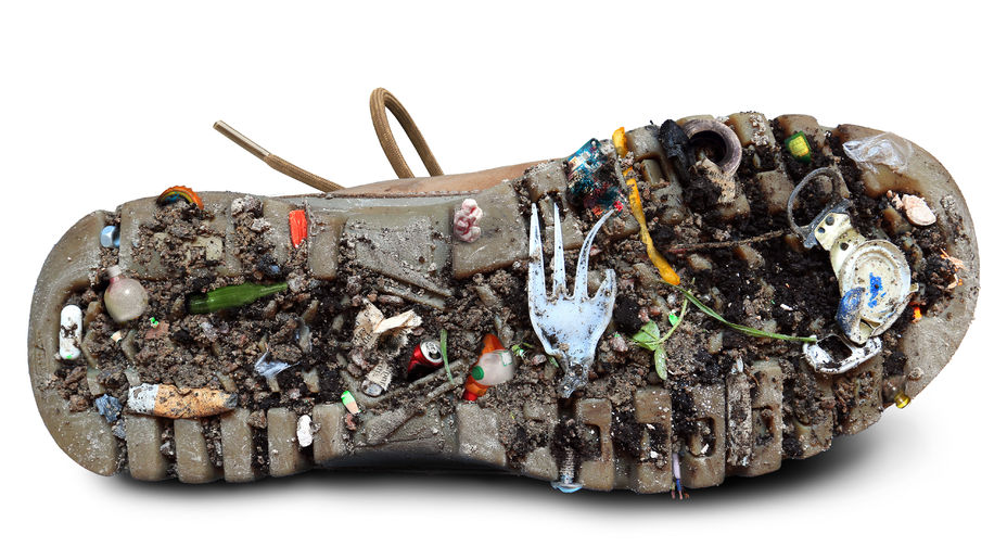 45153424 - sole of the shoe with dirt and garbage, the theme of ecology
