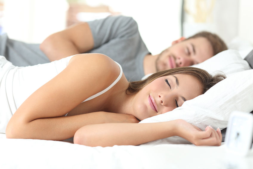 50325497 - happy couple sleeping in a comfortable bed at home