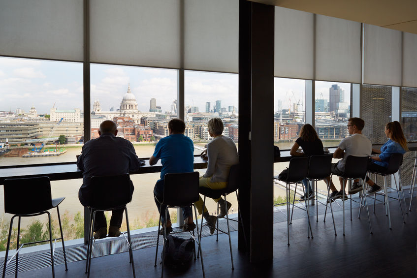 51841774 - tate modern art gallery cafe interior with people and city view in london