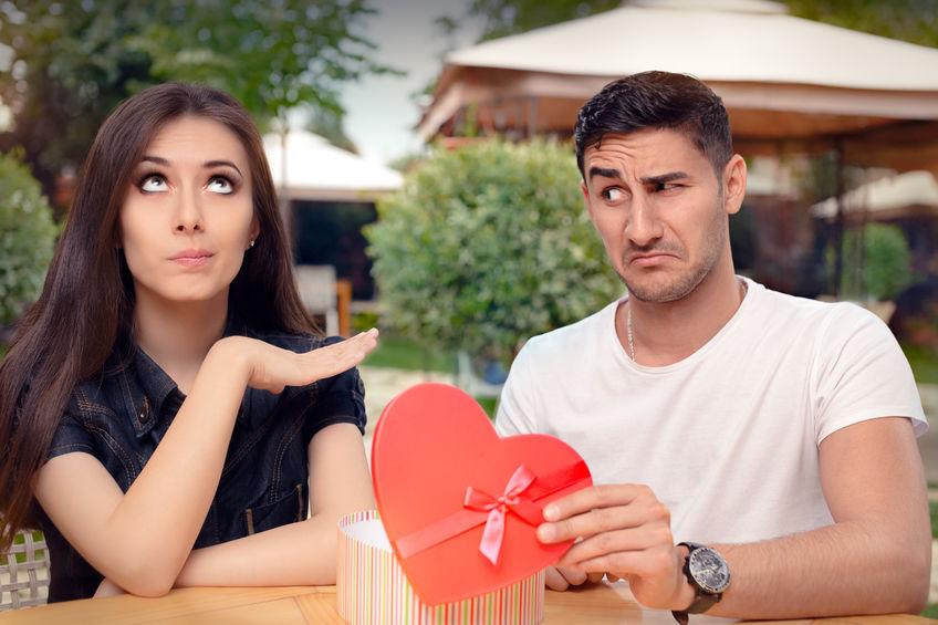 51897322 - girl refusing heart shaped gift from her boyfriend