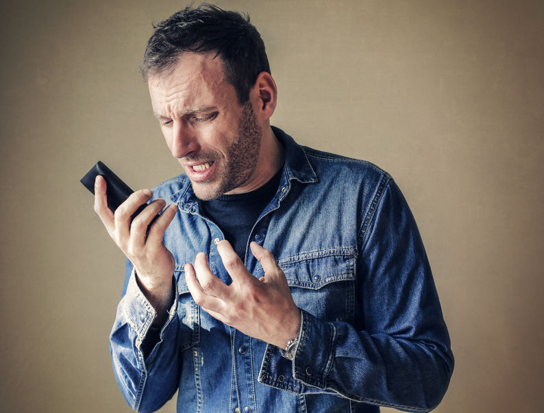 59926894 - disappointed man holding his phone