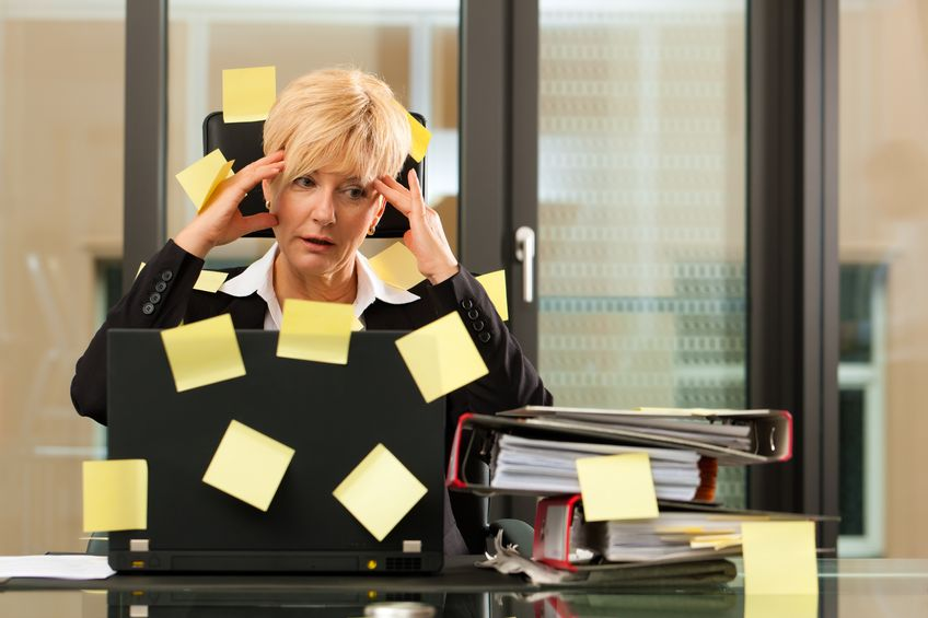 11193721 - a woman has stress in the office - multitasking and time management