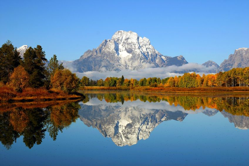 13147247 - reflection of mountain range in a lake at grand teton national park