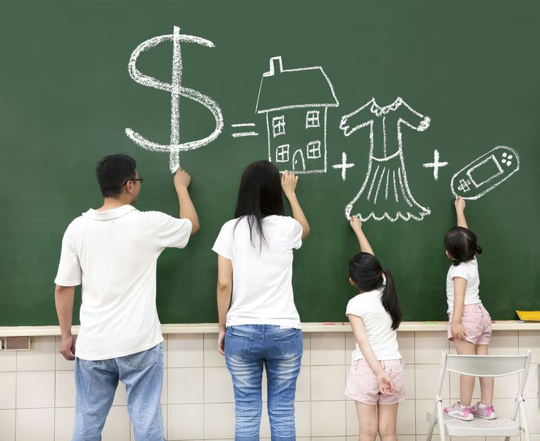 15905445 - family drawing money house clothes and video game symbol on the chalkboard