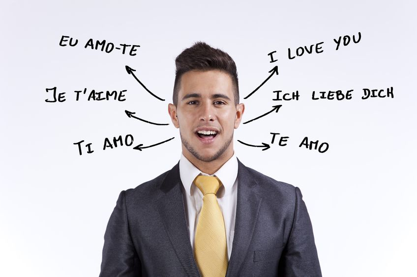 16388560 - happy businessman saying i love you in portuguese, french, english, italian, spanish and german