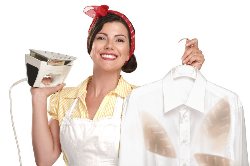 20888601 - happy beautiful woman housewife ironing a shirt on white