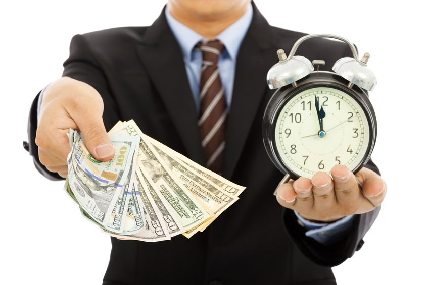 30531305 - businessman holding money and clock
