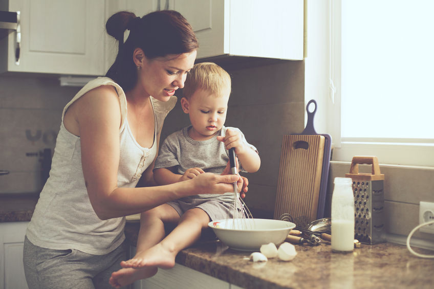 41178667 - mom with her 2 years old child cooking holiday pie in the kitchen to mothers day, casual lifestyle photo series in real life interior