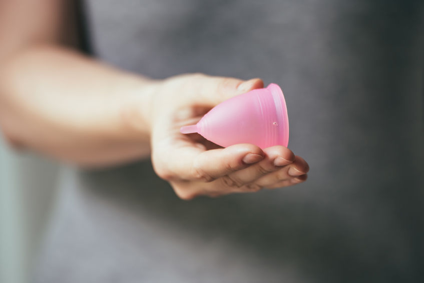 41238774 - young woman hand holding menstrual cup