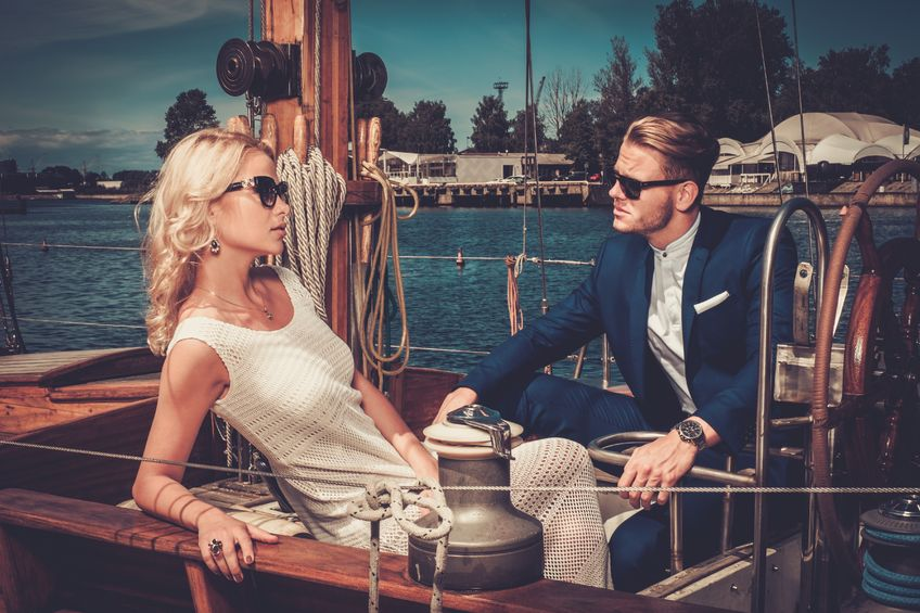 42859889 - stylish wealthy couple on a luxury yacht