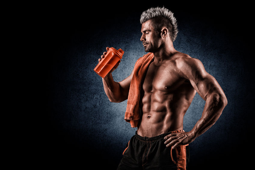 43856014 - young handsome man with strong muscles, protein drink after training