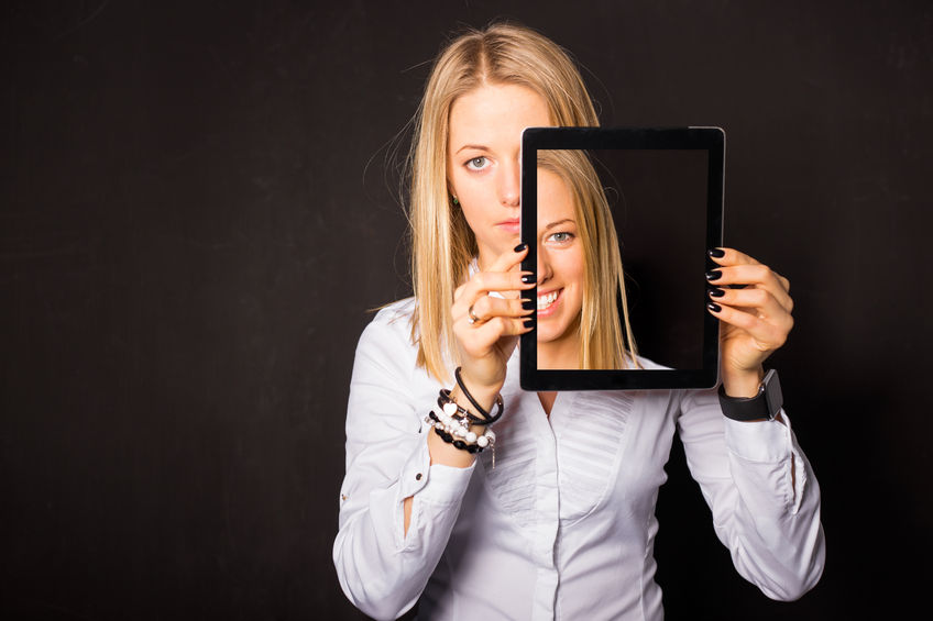 52546378 - woman standing with tablet in her hands