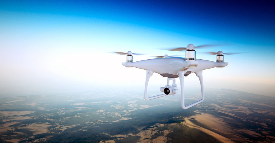 57836140 - photo white matte generic design air drone with action camera flying sky under earth surface.uninhabited desert mountains sunset background.horizontal,front top angle view.film effect. 3d rendering