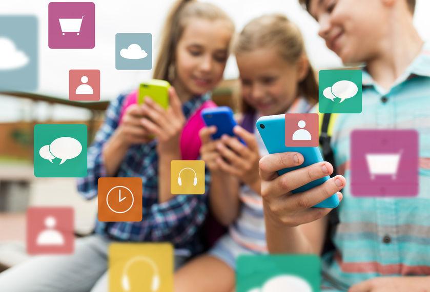 73726941 - elementary school students with smartphones