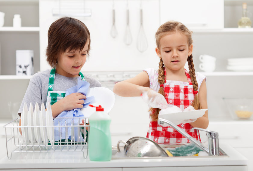 26398482 - kids washing the dishes in the kitchen together - helping out with the home chores