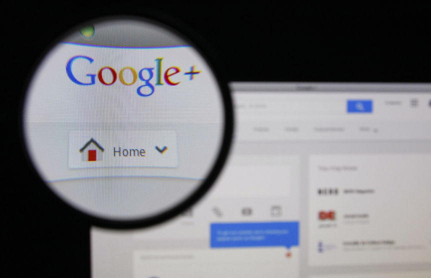 34778272 - lisbon - january 14, 2014: photo of google+ homepage on a monitor screen through a magnifying glass.