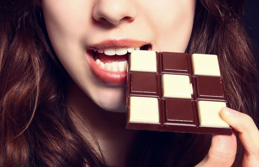43271048 - closeup of woman eating chocolate