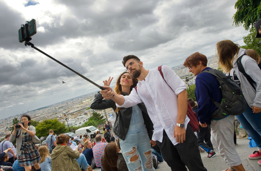 44268214 - paris, france - july 27, 2015: a couple is making a selfie in front of the sacre coeur in montmartre in paris in france