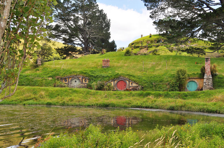 23762064 - hobbiton, shire, new zealand. reflection of house on lake.